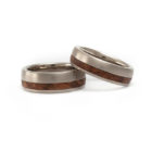 "<div class=""fancy-desc""><div class=""fancy-desc-left""><span class=""secondary label radius"">wedding rings</span> <span class=""secondary label radius"">wood</span> <span class=""secondary label radius"">organic materials</span> <span class=""secondary label radius"">natural white gold</span> <span class=""success label radius"">New</span></div><div class=""fancy-desc-right""><div class='fb-share-button' data-href='https://www.cf-creation.ch/en/2019_09_mg_022/' data-layout='button' data-size='small' data-mobile-iframe='true'></div></div></div>"